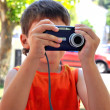 Even little boy can use digital camera — Stock Photo