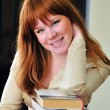 Clever redheaded girl — Stock Photo