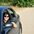 Happy girl drive her car in the countrys — Stock Photo