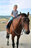 The first time on the horse — Stock Photo