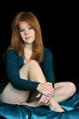 Sitting redheaded girl — Stock Photo