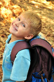 Schoolboy in fall time — Stock Photo