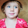 Blue-eyed  girl in huge hat — Stock Photo