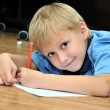 Left-hander boy is drawing — Stock Photo