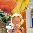 Girl enjoys an ice-cream — Stock Photo