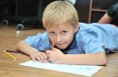 Boy drowing — Stock Photo