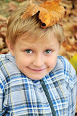 Boy with leaf on head — Stock Photo