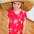 Funny girl wearing huge hat — Stock Photo