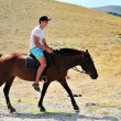 Man riding a horse — Stock Photo #1583673