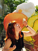 Woman eating melting ice cream — Stockfoto