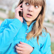 Teenager girl talking by cellular phon - Stock Photo