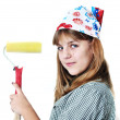 Cute teenage girl using roller to paint wall isolated on the white background — Stock Photo #1843687