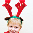 Little boy with christmas antlers — Stock Photo