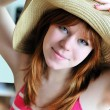 Stock Photo: Pretty girl wearing straw hat