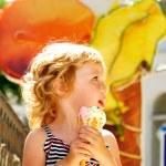 Girl eating ice cream cone — Stock Photo