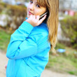 Teenager girl talking by cellular phone - Stock Photo
