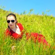 Girl in grass - Stock Photo