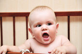 Funny baby in her bad — Stock Photo