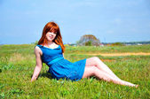 Redheaded beauty on the meadow — Stock Photo