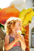 Girl eating ice cream cone — Stock Photo