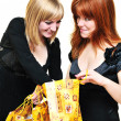 Stock Photo: Two curious shopping girls
