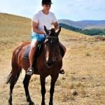 Man riding a horse — Stock Photo #2327700
