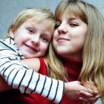 Brothe hugging sister — Stock Photo #2379557