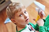Scissoring boy — Stock Photo