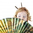Little girl with fan — Stock Photo