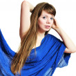 Girl under blue scarf — Stock Photo
