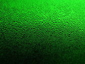 Green glass with drops 2 — Stock Photo