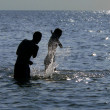 Girl and youth playing in the sea 3 — Stock Photo