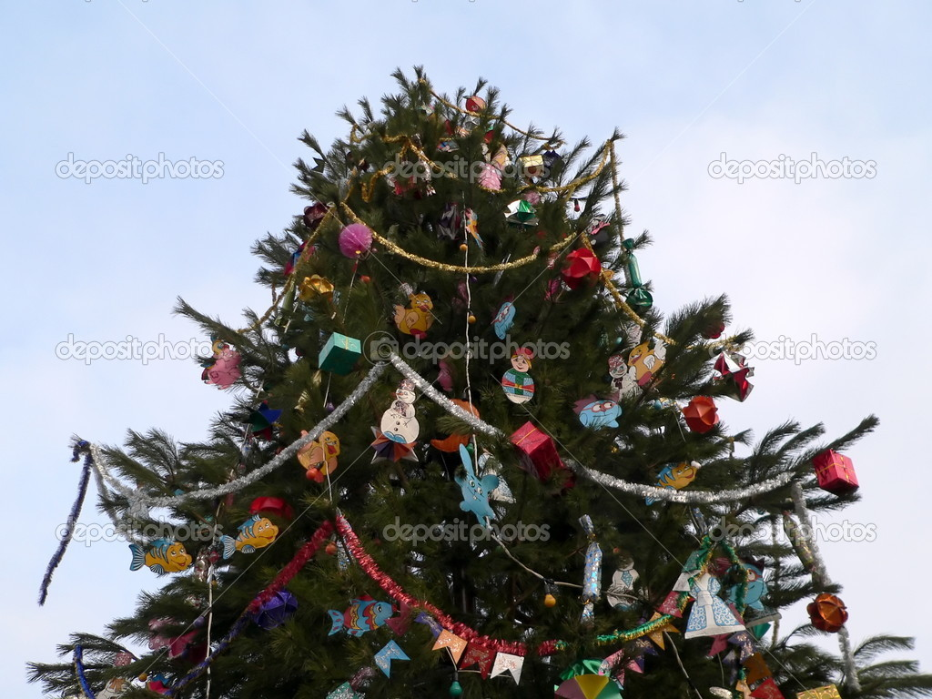 Xmas fir-tree on the blue sky background — Stock Photo #1254938