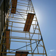 Scaffolding on blue sky background — Stock Photo #1402587