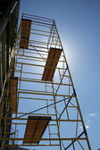 Scaffolding on blue sky background — Stok fotoğraf