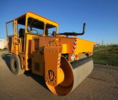 Orange road-roller — Stock Photo