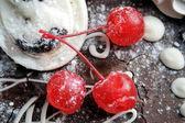 Three red sweet cherry — Stock Photo