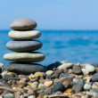 Stack of stones on beach - Stock Photo