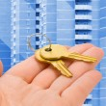 Hand giving keys — Stock Photo
