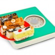 Cakes on weight scale — Stock Photo #1180123