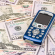 Mobile phone on money background — Stock Photo #1181048