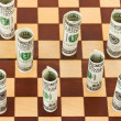 Money on chess board — Stock Photo #1181898