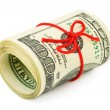 Roll of money and bow — Stockfoto