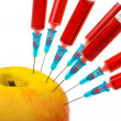 Apple and syringes - Stock Photo