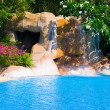 Pool and waterfall in hotel — Stock Photo