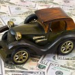 Toy retro car on money background — Stock Photo