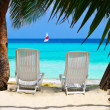 Chairs on tropical beach — Stock Photo #1184774