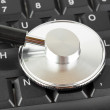 Stethoscope on computer keyboard — Stock Photo