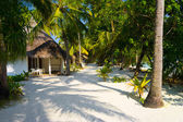 Bungalows on beach and sand pathway — Stock Photo