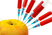 Apple and syringes — Stock Photo